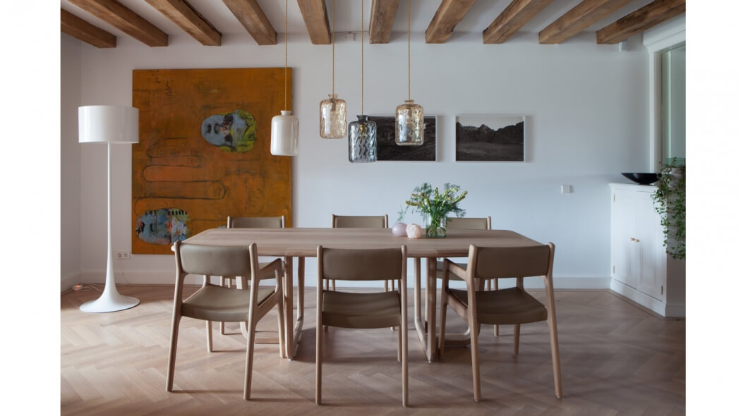 Residential project in Amsterdam with interior design by Evelijn Ferwerda with Holy Table and Deer Chair by Autoban via Suite Wood