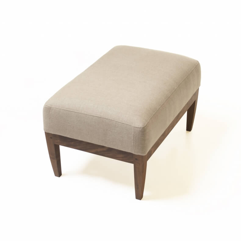 Low Ottoman Chair in walnut designed by Matthew Hilton and manufactured by De La Espada