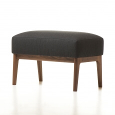 Mira Ottoman in walnut designed by Matthew Hilton and manufactured by De La Espada