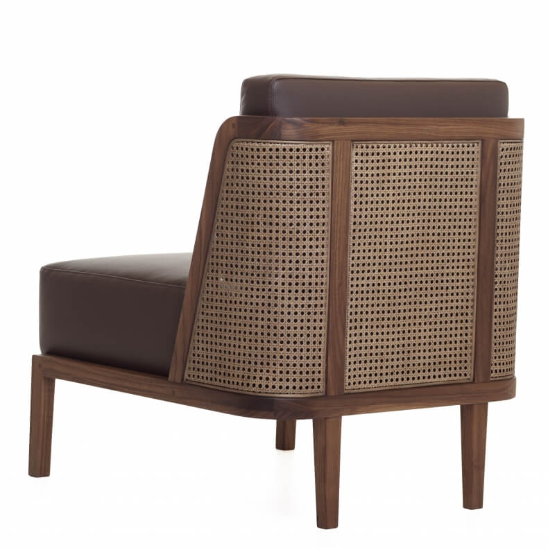THRONE LOUNGE CHAIR WITH RATTAN SHOWN IN DANISH OILED WALNUT AND LEATHER